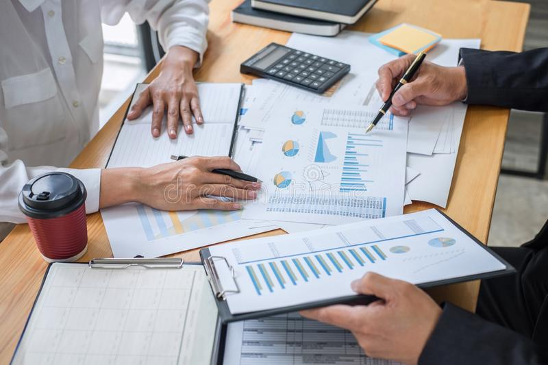 Business team consultant working with new startup growth project plan and discussion analyzing for financial strategy statistics stock image