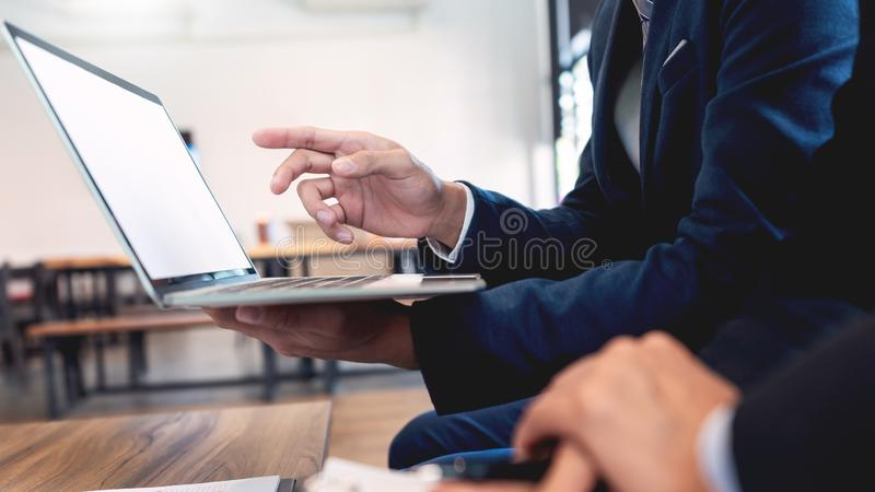 Business team cooperation coworking discussing about progress of business plan project advice and correcting mistakes during work royalty free stock photo