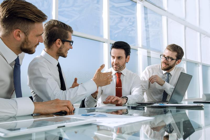 Business team discusses business issues at the working meeting royalty free stock photo