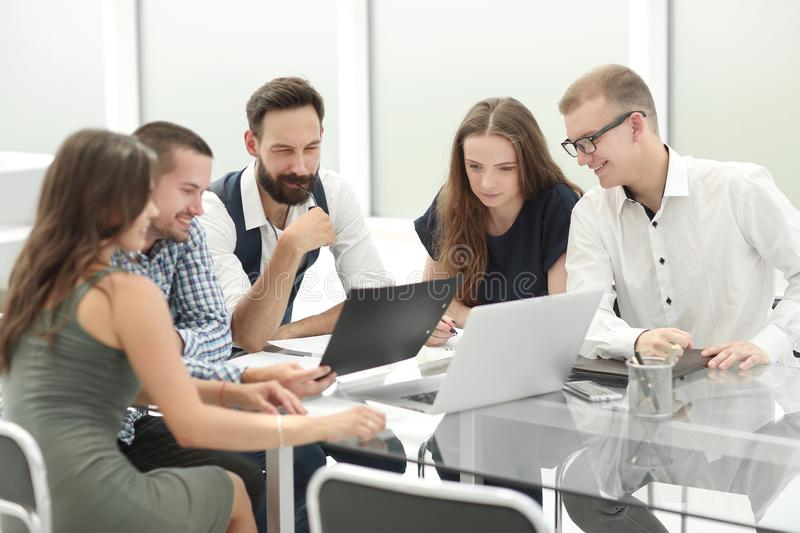 Business team discusses the results of their work stock images