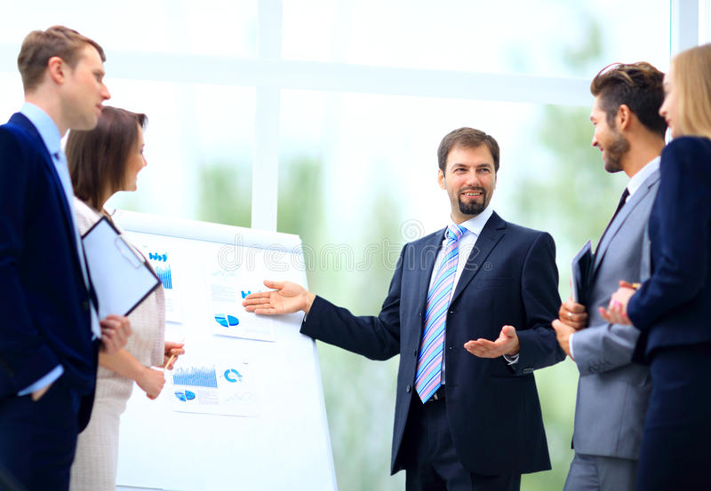 Business team discussing acquisition in meeting royalty free stock photography