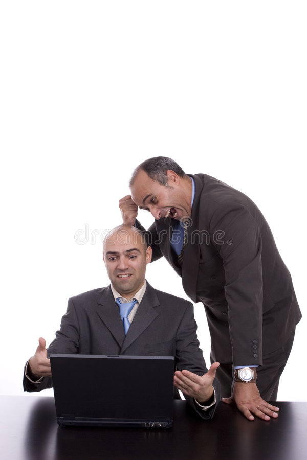 Business team discussing around laptop stock photography