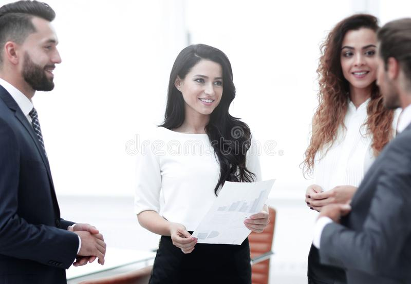 Business team discussing a financial chart stock photos