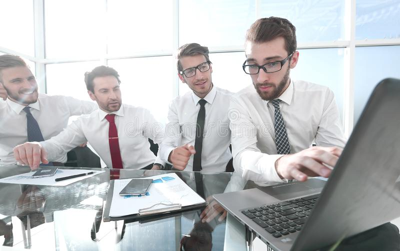 Business team discussing financial data stock photos