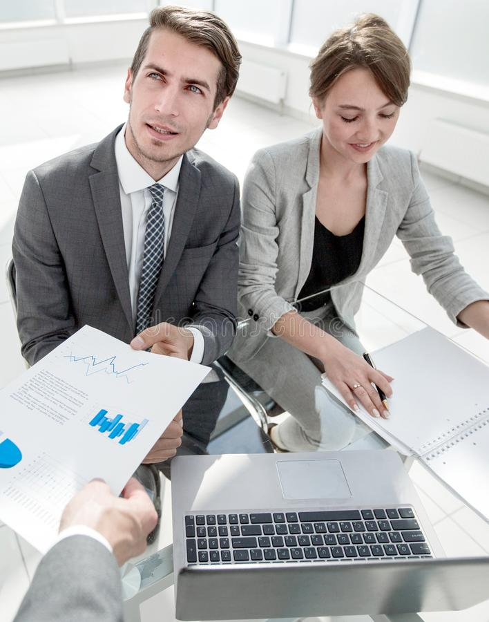 Business team discussing financial documents. royalty free stock photo