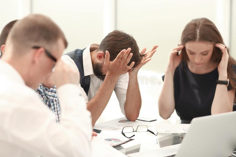 Business team discussing financial problems of a new startup royalty free stock image