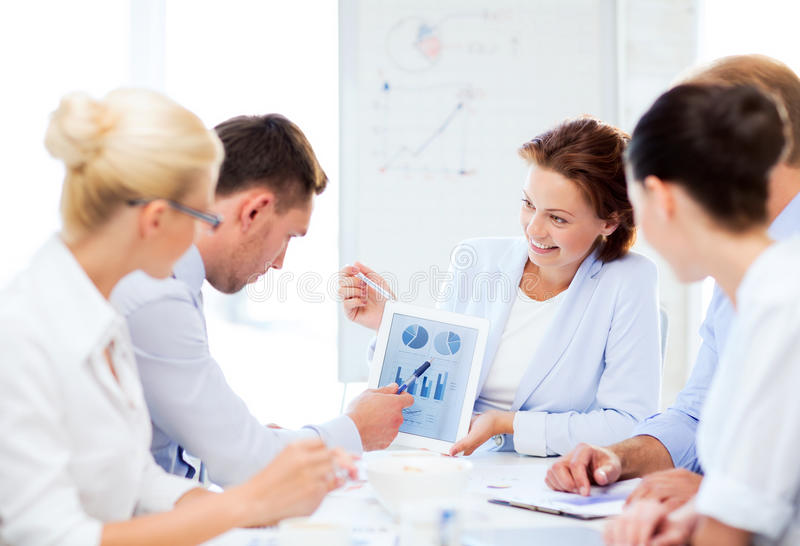 Download Business Team Discussing Graphs In Office Stock Image - Image: 32738755