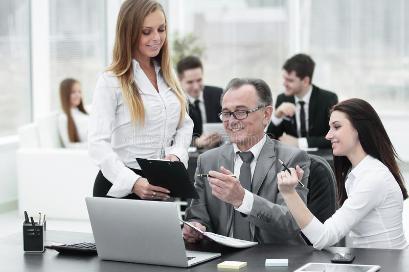 Business team discussing with the head of financial data stock image