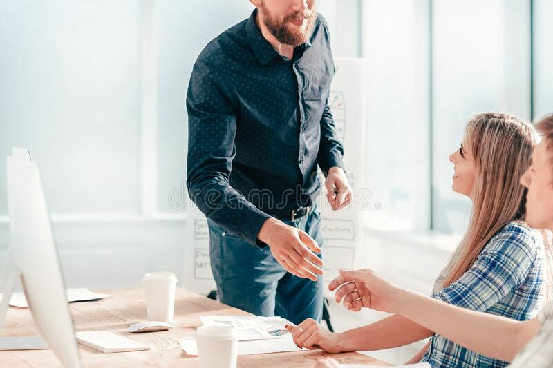 Business team discussing new ideas at a meeting in the office stock images