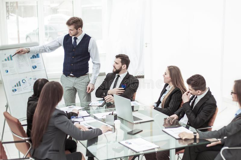 Business team discussing the presentation of a new financial project on a workplace at office royalty free stock images