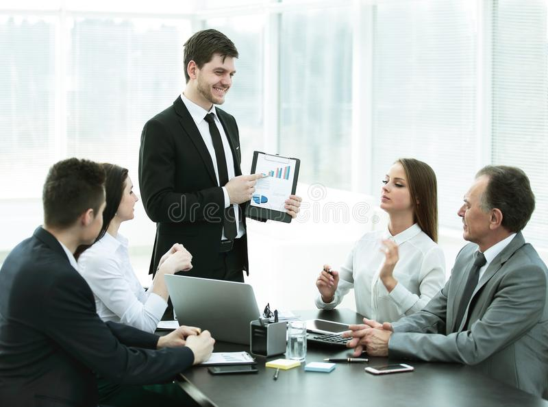 Business team discussing a successful financial project. royalty free stock image