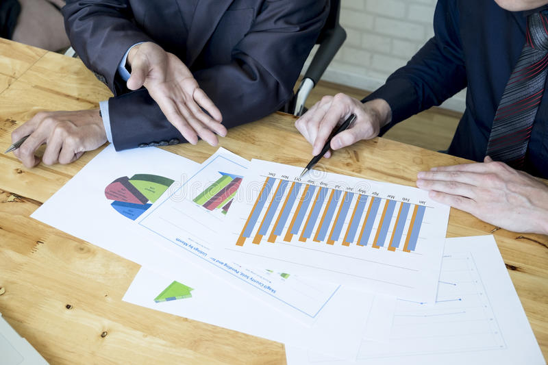 Business team discussing their ideas in office. Working collaborate together. Analysis the chart. stock images