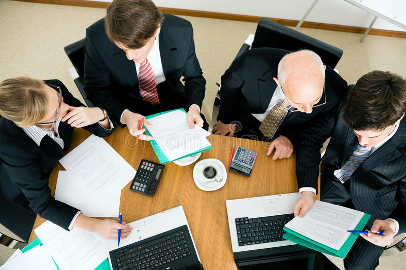 Business Team discussing various proposals royalty free stock photo