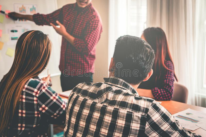 Business team discussing on white board in meeting royalty free stock images