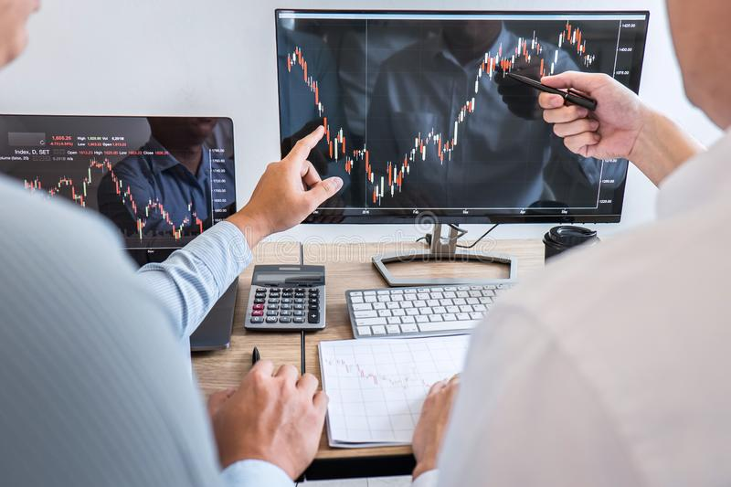 Business team discussion on meeting to planning investment trading project and strategy to investor of deal on a stock exchange stock photography