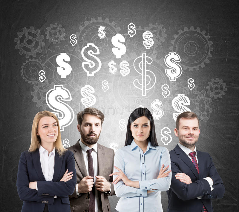 Business team, dollar signs and cogs. Group of young people is standing with crossed arms near a blackboard with dollar signs drawn on it stock photos