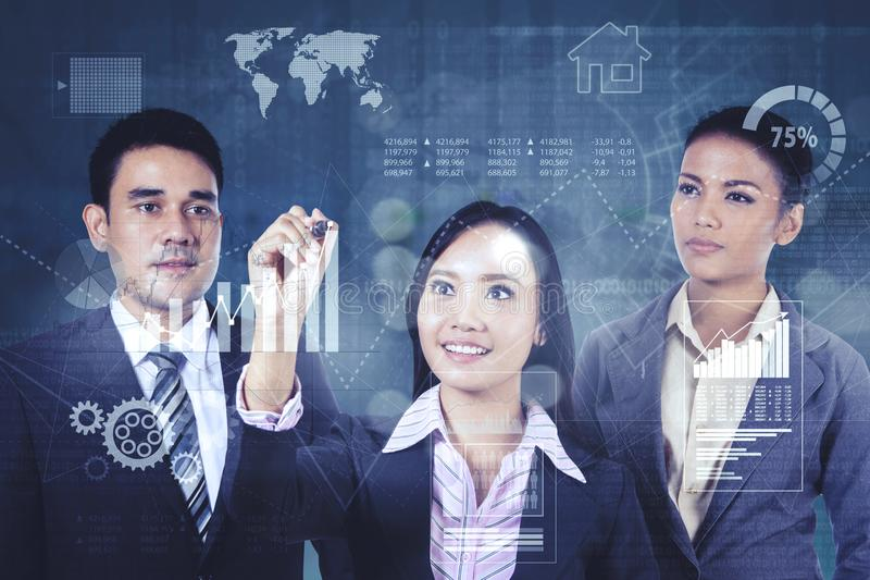 Business team drawing growth finance graph stock photo