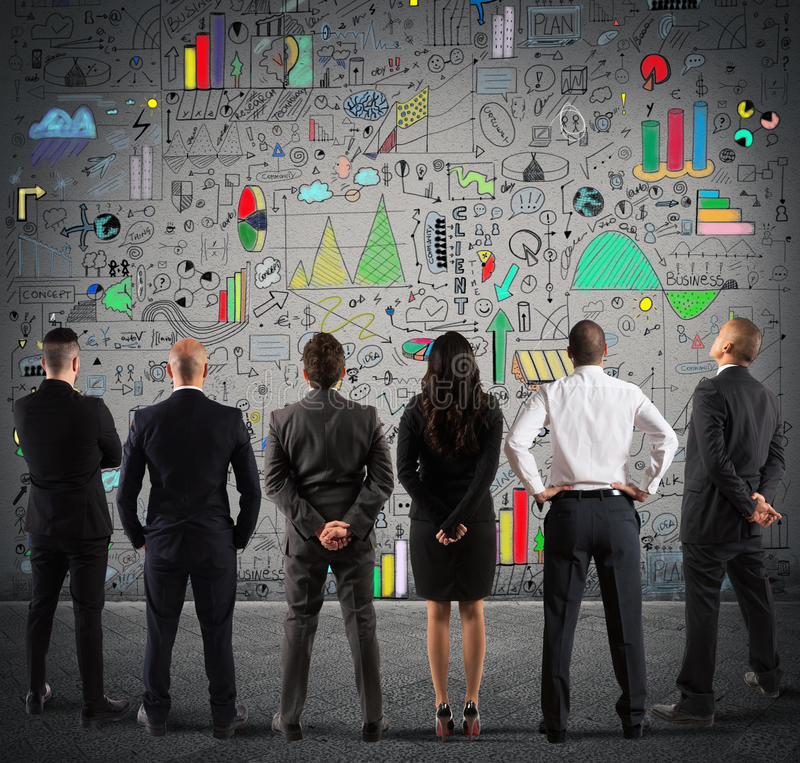 Business team drawing a new complex project royalty free stock photography