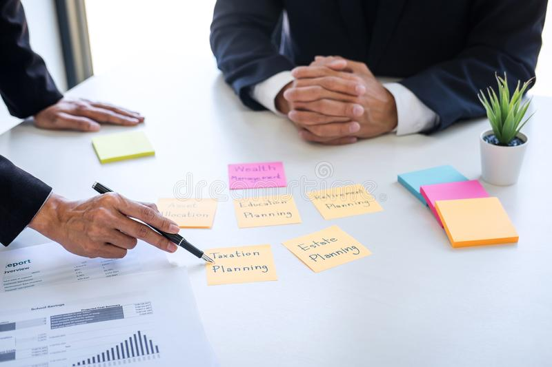 Business team executive accounting analyzing and calculation on valuation data investment fund looking at report, sticky note royalty free stock photography