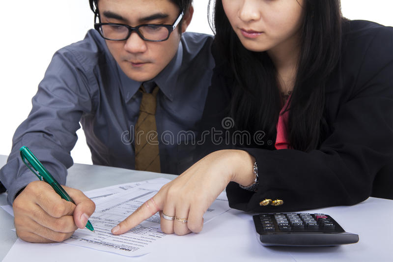 Business team filling out tax form stock photos