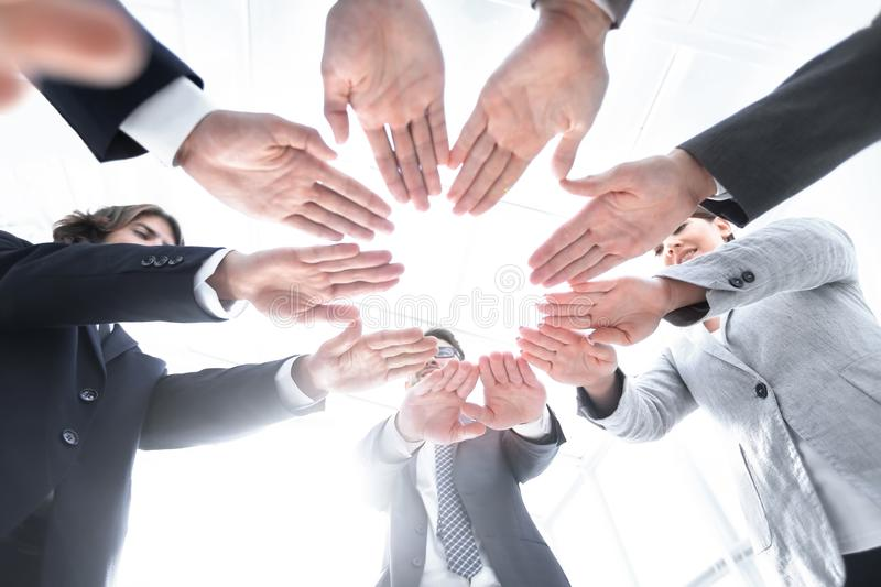 Business team with folded their hands in a circle. Concept of teamwork. business team with folded their hands in a circle royalty free stock images