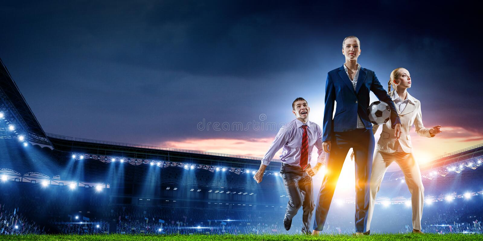 Business team on football stadium. Mixed media stock images