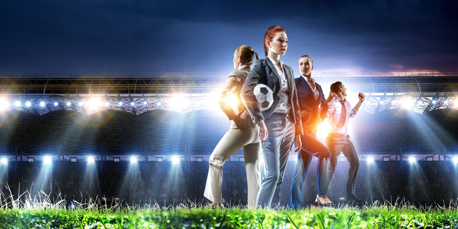 Business team on football stadium. Mixed media stock photography