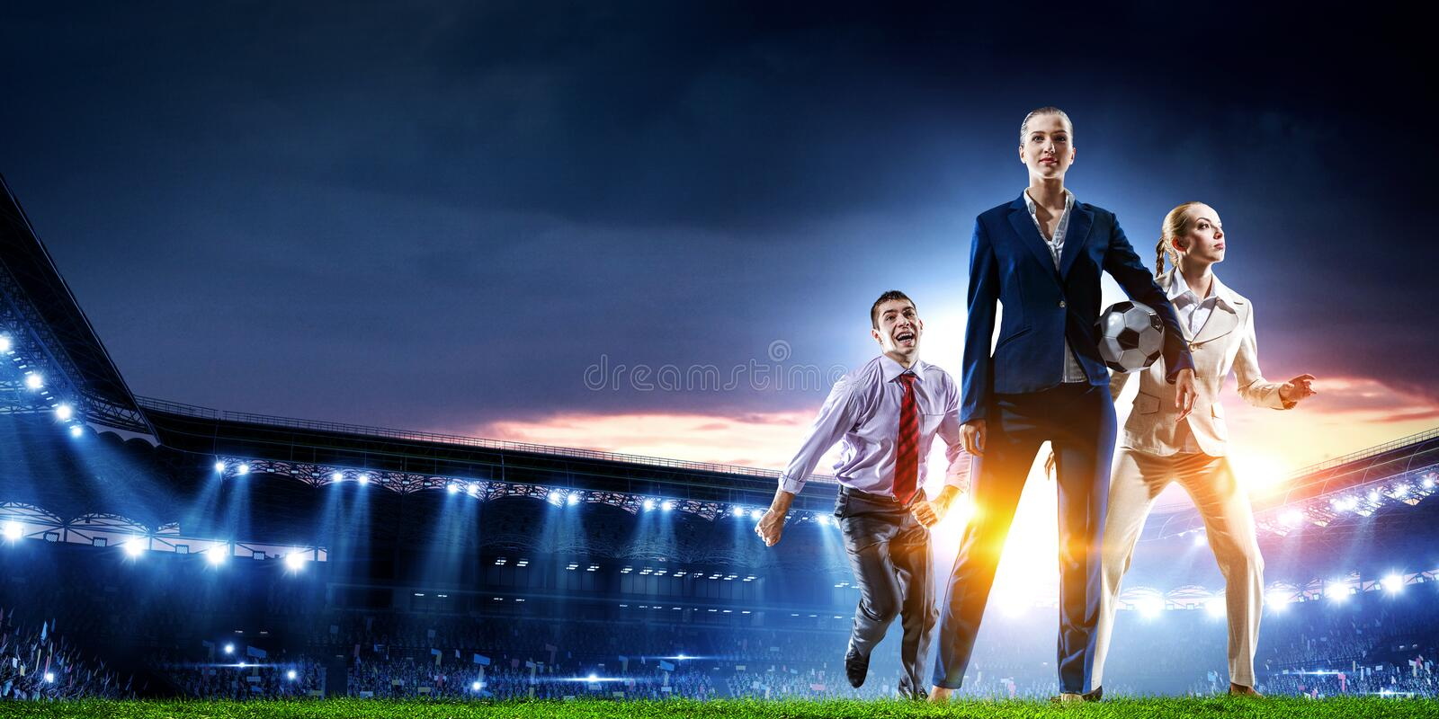 Business team on football stadium. Mixed media stock photos