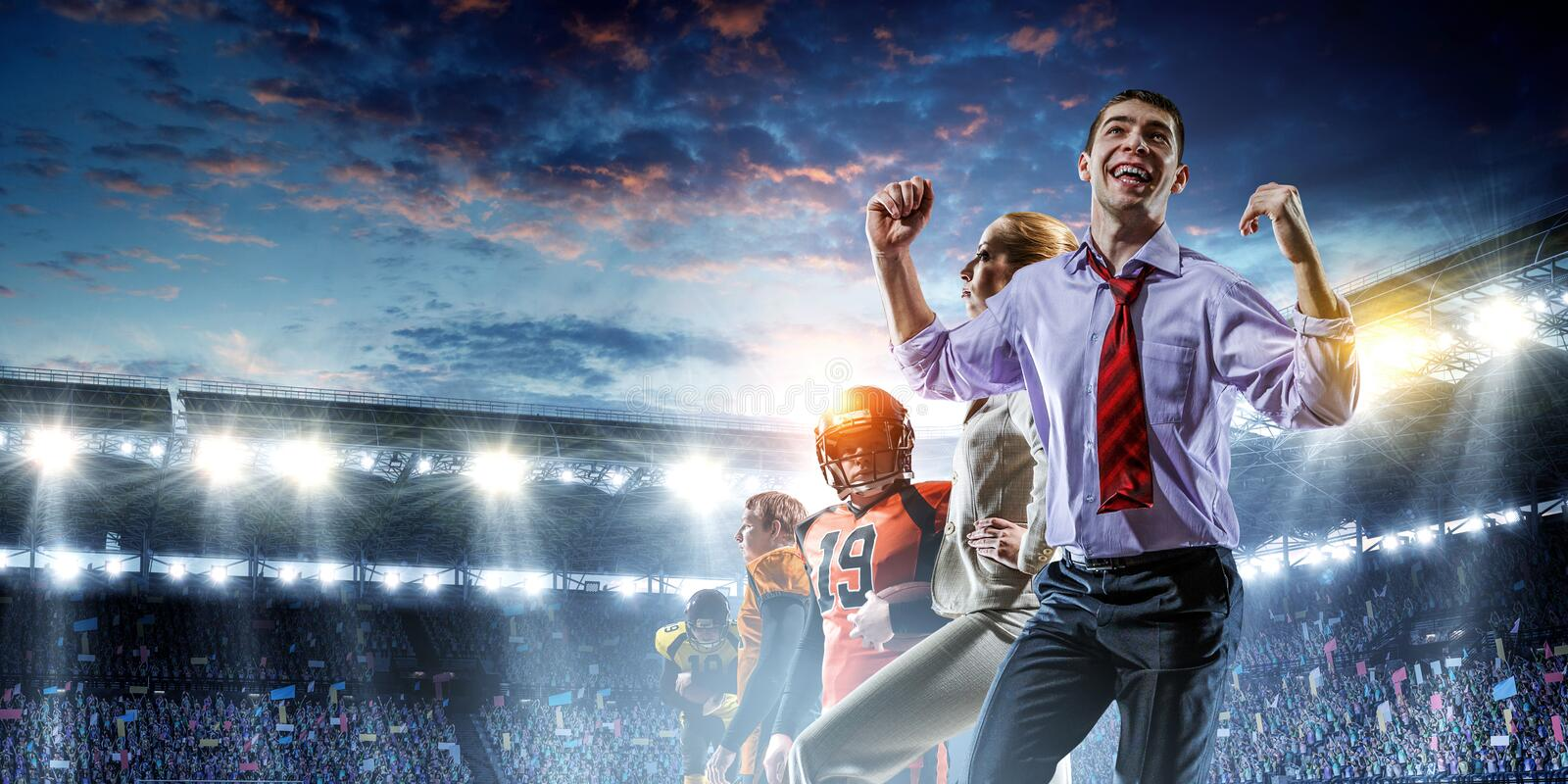 Business team on football stadium. Mixed media royalty free stock image