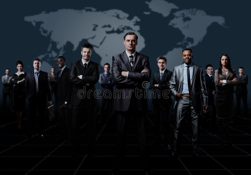 Business team formed of young businessmen standing over a dark background. Business team formed of young businessmen standing over a dark background royalty free stock images