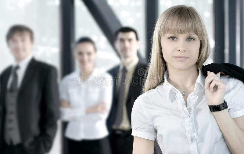 Download A Business Team Of Four Persons In A Modern Office Royalty Free Stock Photography - Image: 16019897