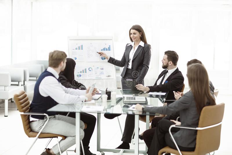 Business team gives a presentation of a new financial project for the business partners of the company. The photo has a empty space for your text royalty free stock images