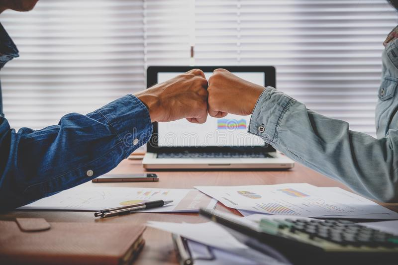 Business team giving fist bump after complete deal. stock image