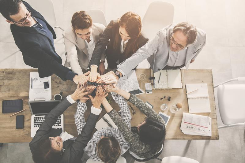Business team is giving high five stock photo
