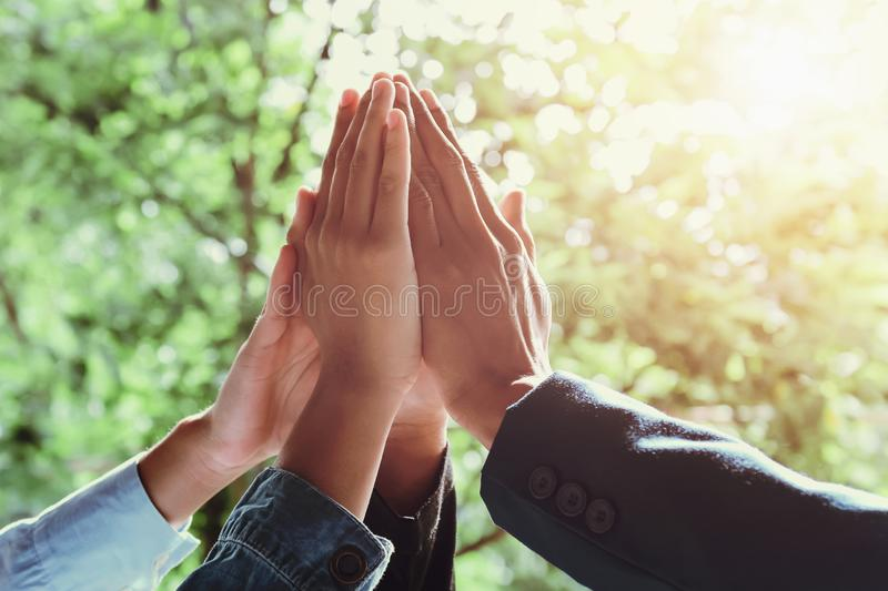 business team giving high five with sunshine background royalty free stock image