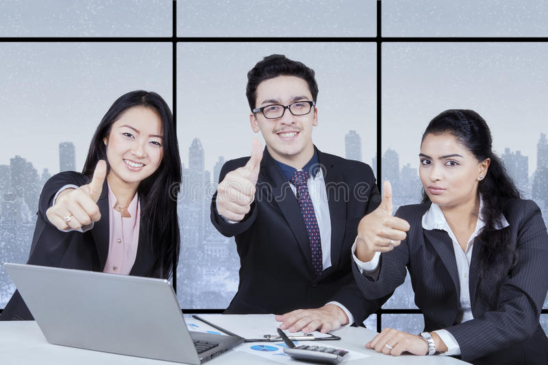 Business team giving thumb stock photo