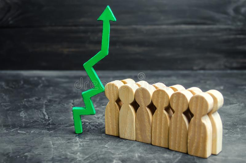 Business team and green up arrow near the employees. The concept of a startup. Successful business growth. Qualification and. Retraining of workers. Starting a stock images