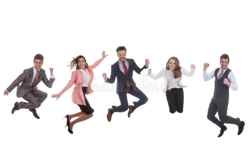 Business team group jumping for success. Happy business team group jumping for success royalty free stock photography