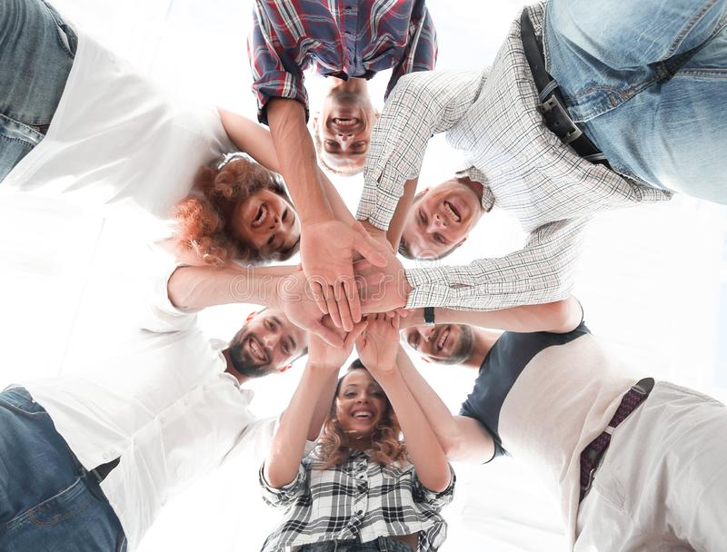 Business team with hands clasped together. Bottom view. business team with hands clasped together.team building royalty free stock images