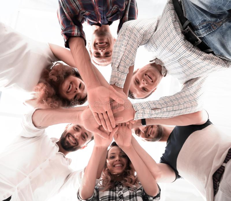 Business team with hands clasped together. Bottom view. business team with hands clasped together.team building stock photo