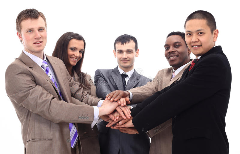 Business team with hands clasped together stock image