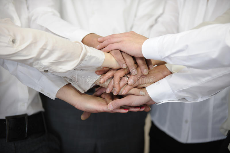 Business team with hands together stock image