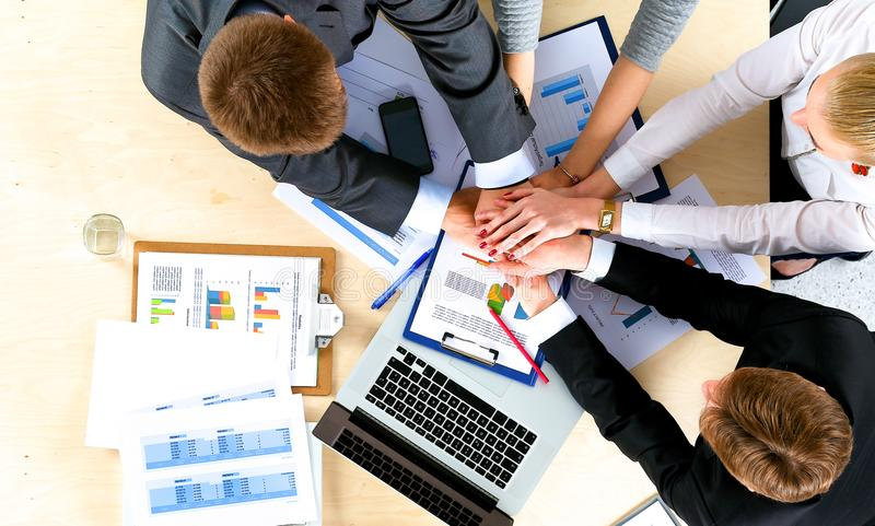 Business team with hands together - teamwork concepts.  royalty free stock images