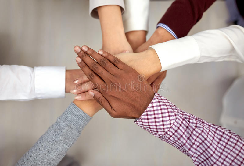 Business team with hands on top at office royalty free stock photo