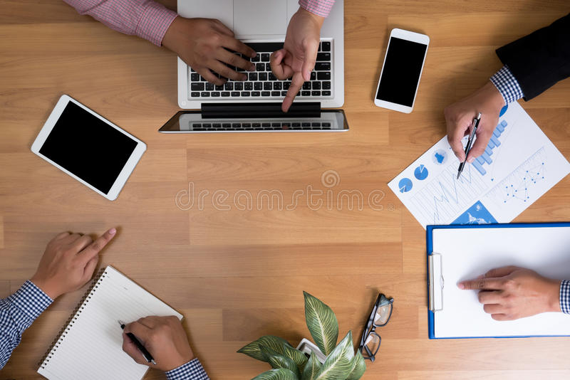 Business team hands at work with financial reports and a laptop, blank copy-space stock photos