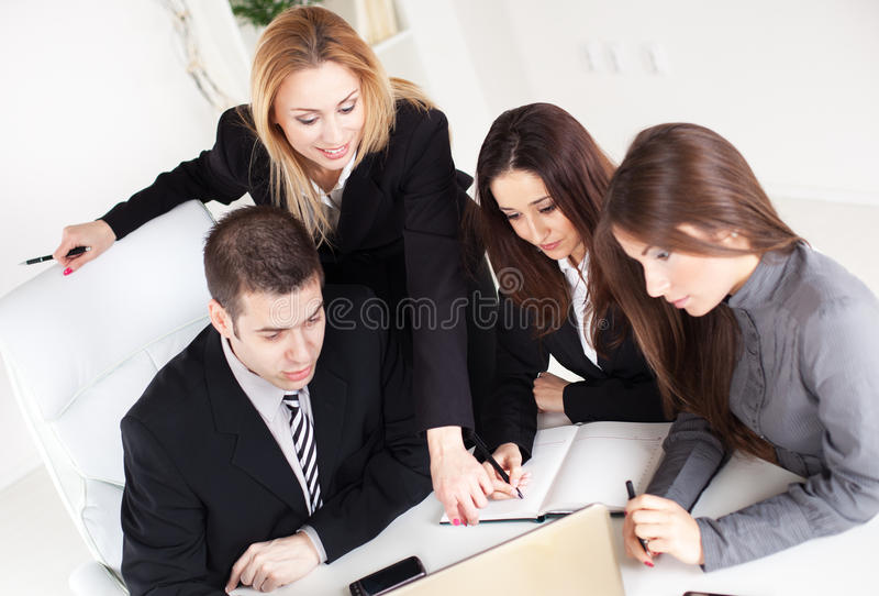 Business Team. Happy Business women showing her colleagues project at laptop in the office royalty free stock photos