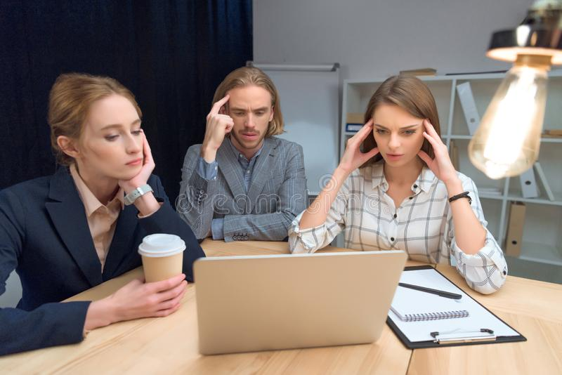 business team have discussion while sitting at table with laptop royalty free stock image