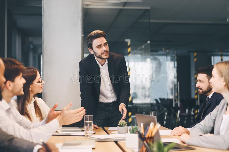 Business team having board meeting in modern office stock images