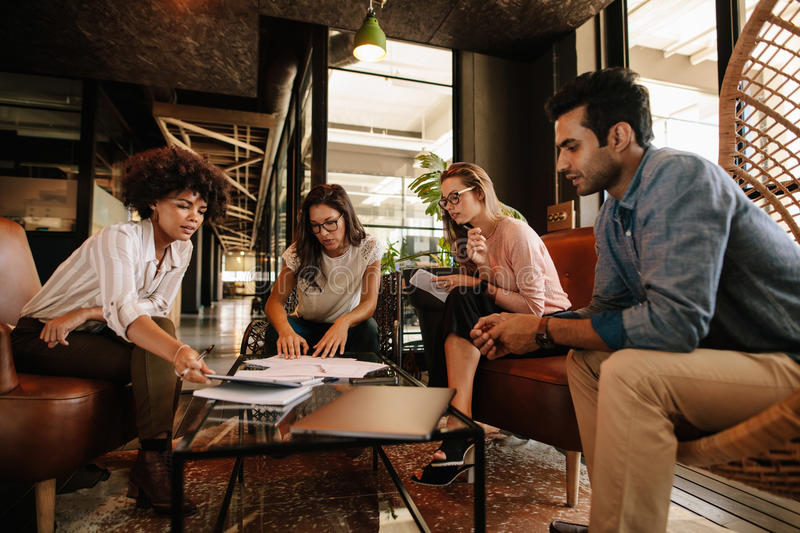 Business team having discussion over new project stock photos