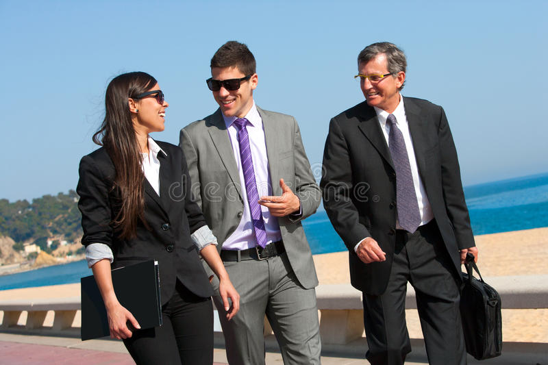 Download Business Team Having A Walk Outdoors. Royalty Free Stock Photos - Image: 24835188